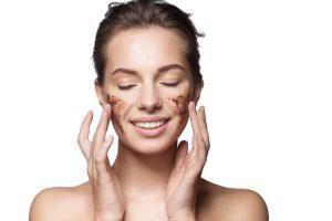 Beautiful girl using exfoliating face wash